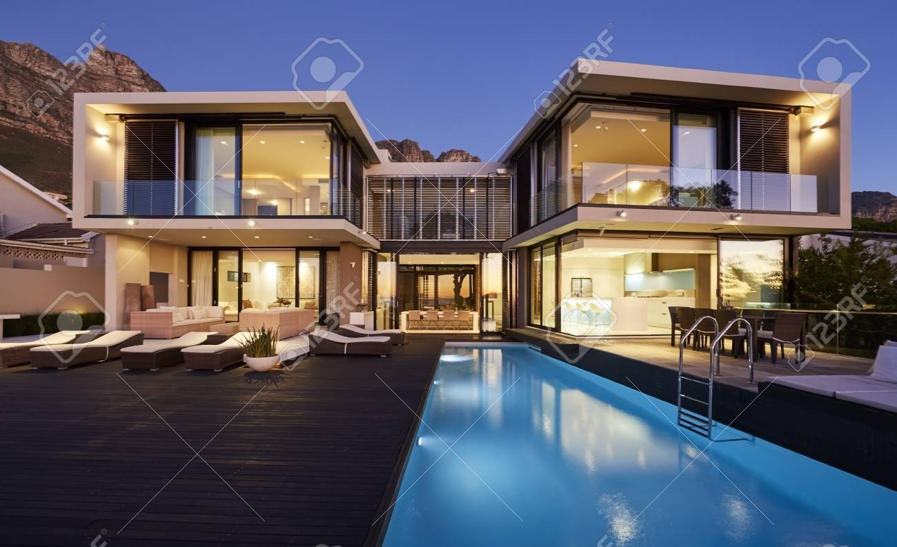 Modern Luxury Home Showcase Exterior And Swimming Pool Illuminated At Night  Stock Photo   78292900