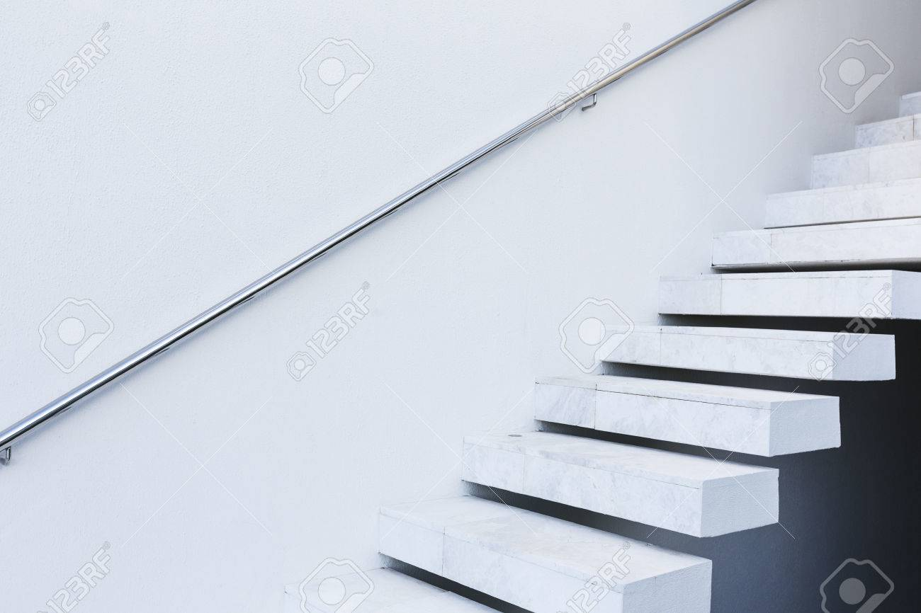 White, Modern, Minimalist Floating Staircase Stock Photo   83637942