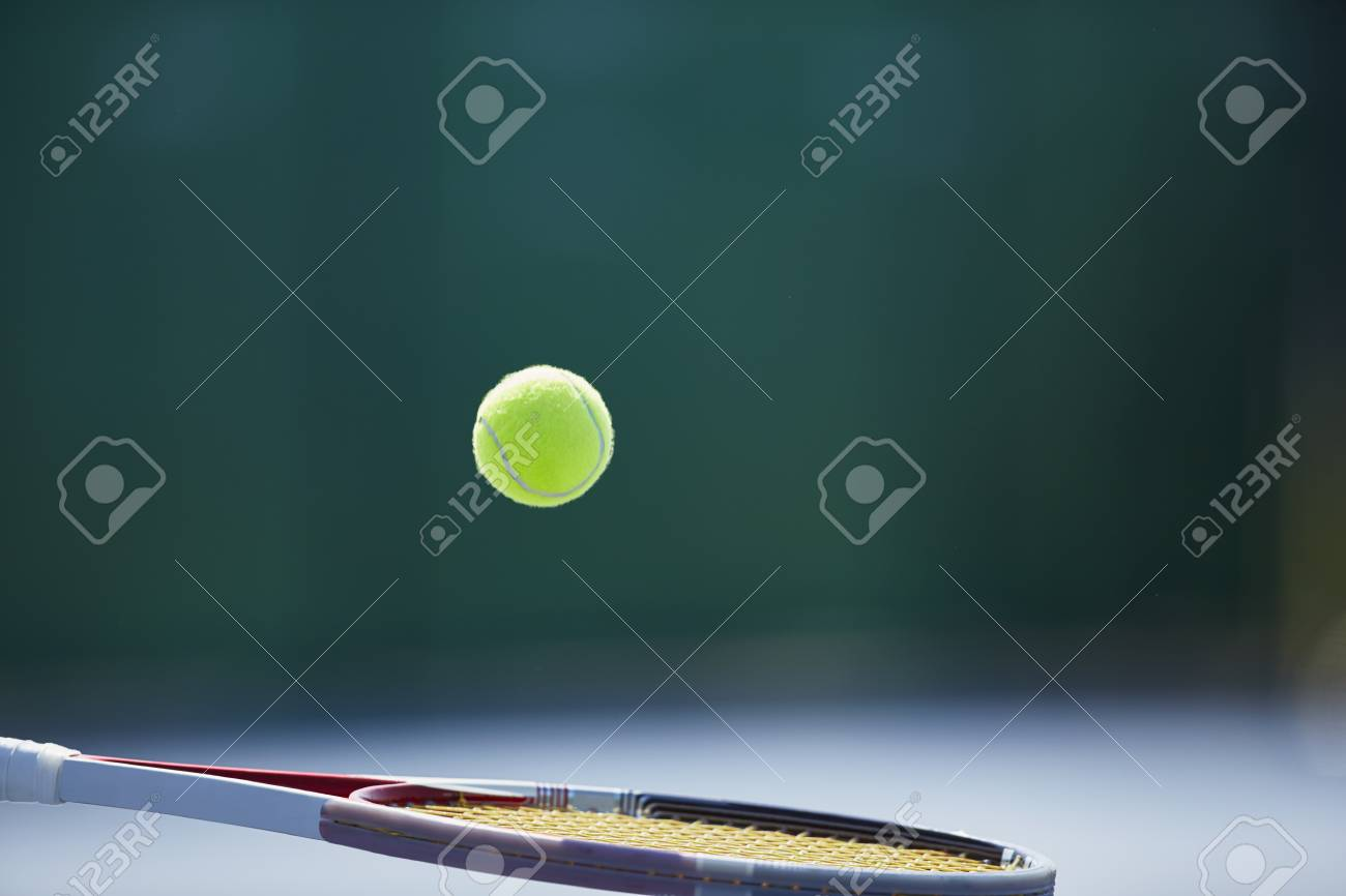 Tennis Ball Bouncing On Tennis Racket Stock Photo Picture And