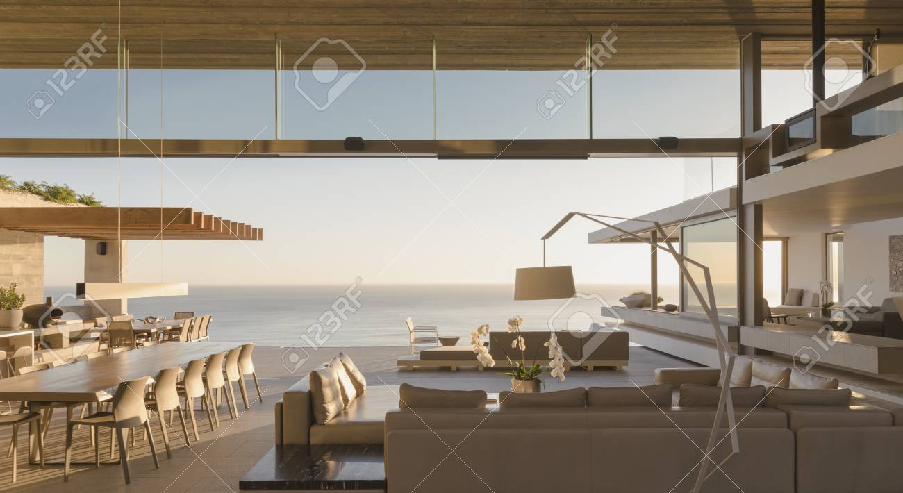 Modern, Luxury Home Showcase Living Room Open To Ocean View Stock ...
