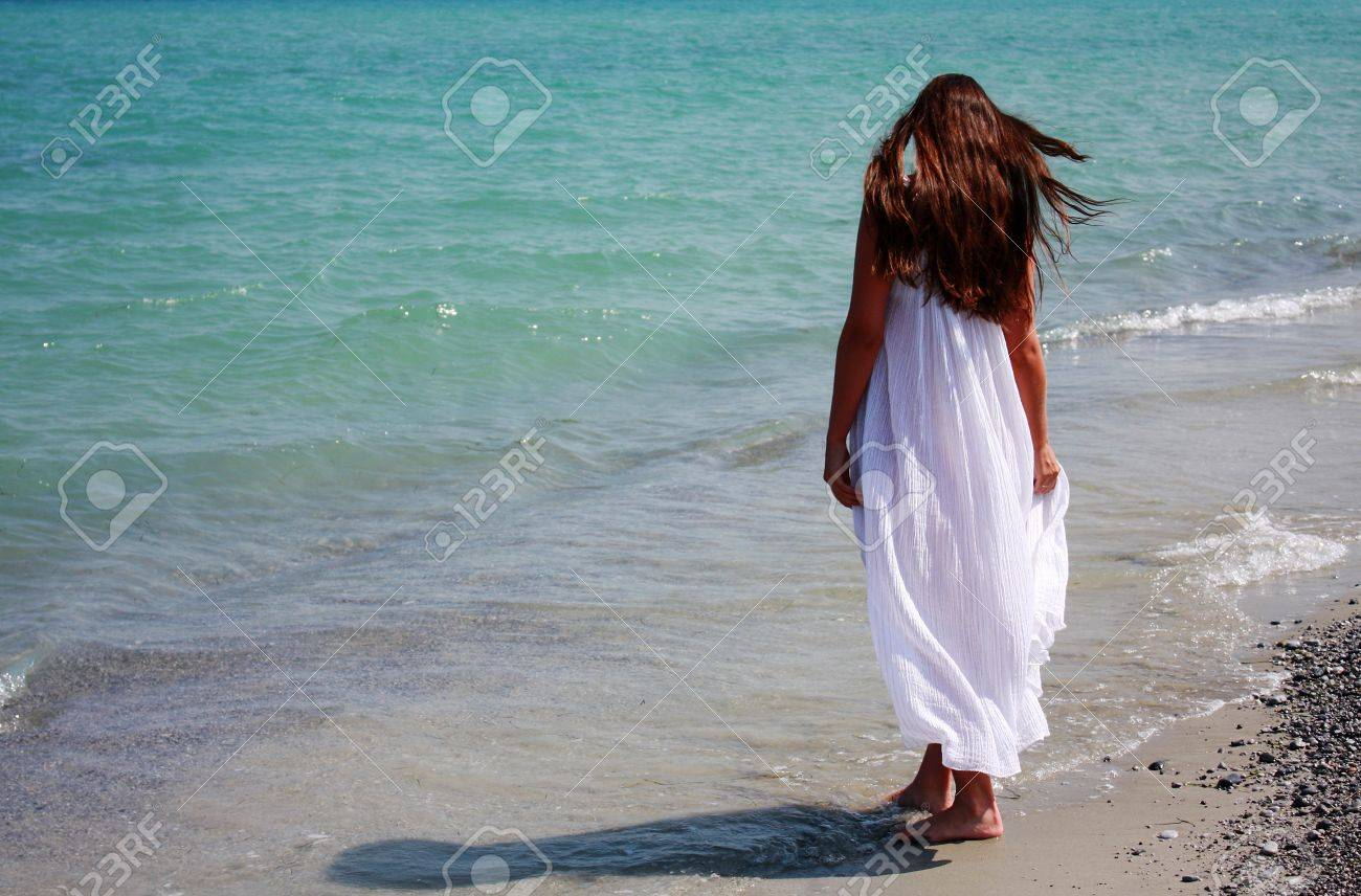 Young woman in long white dress, on the Aegean Sea. Greece Stock Photo - 7618616