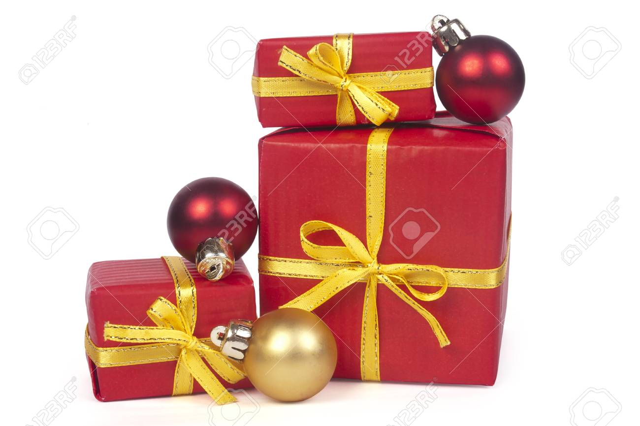 Christmas gifts with red and golden balls isolated on white background Stock Photo - 11464342