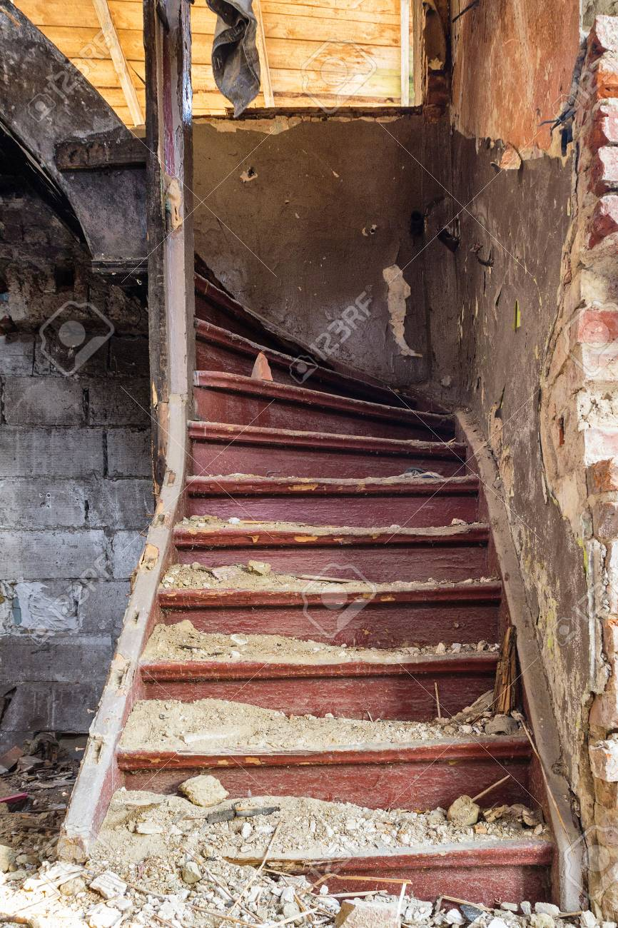 Old staircase in an abandoned house that has been after the earthquake Stock Photo - 25922349