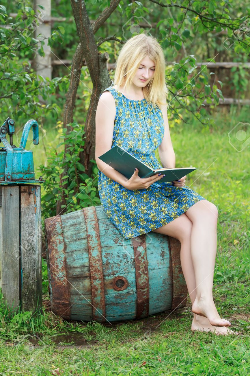 https://previews.123rf.com/images/newrock555/newrock5551504/newrock555150400022/39172344-barefoot-student-girl-in-summer-garden-is-reading-opened-book-with-blue-cover.jpg