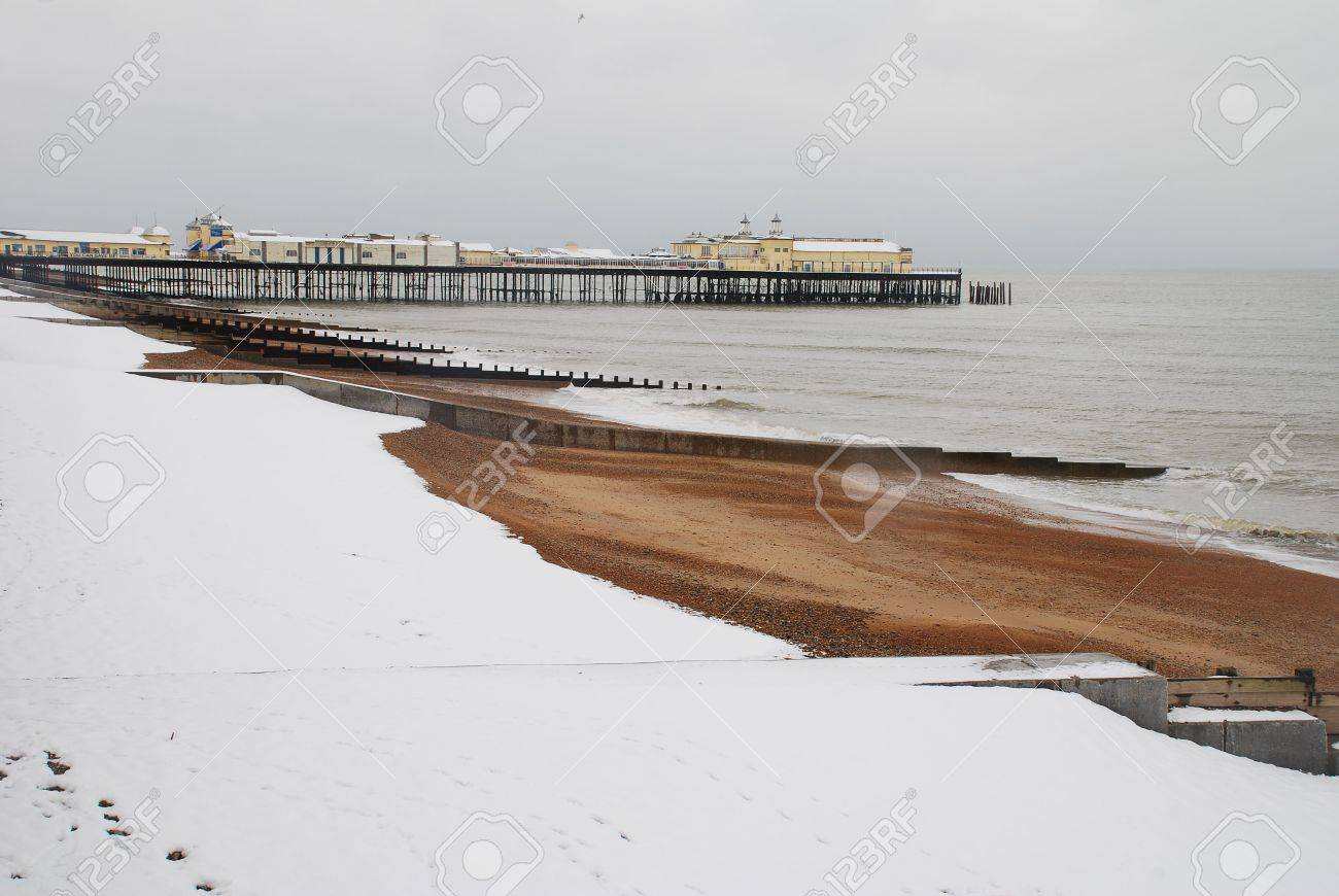 Hastings, England - February 11, 2010 - The snow covered beach with the Victorian pier in the background, during Britains worst winter in years. Stock Photo - 6896149
