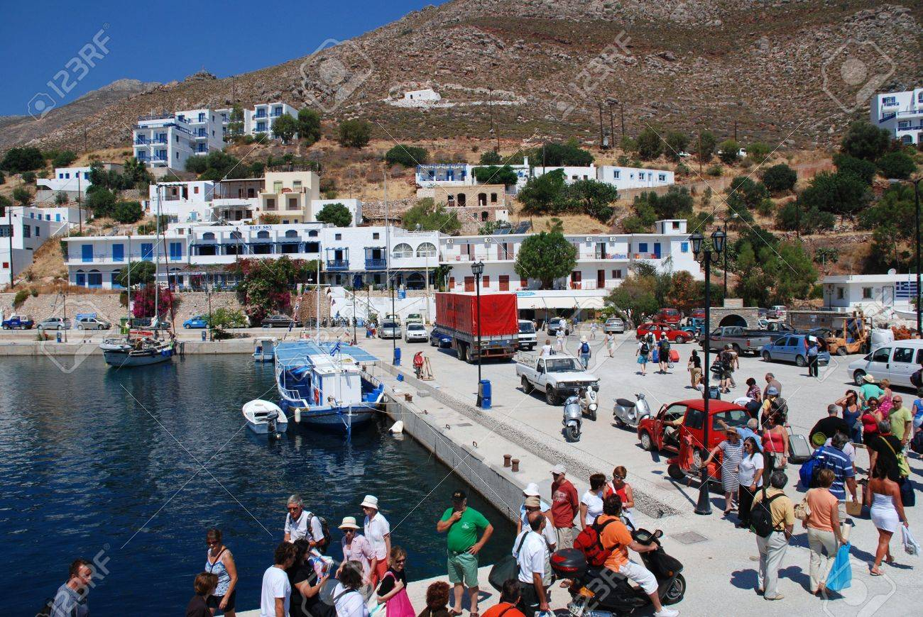 Tilos, Greece - June 12, 2010 - Passengers disembark from a ferry boat at Livadia harbour on the Greek island of Tilos. Stock Photo - 7514780