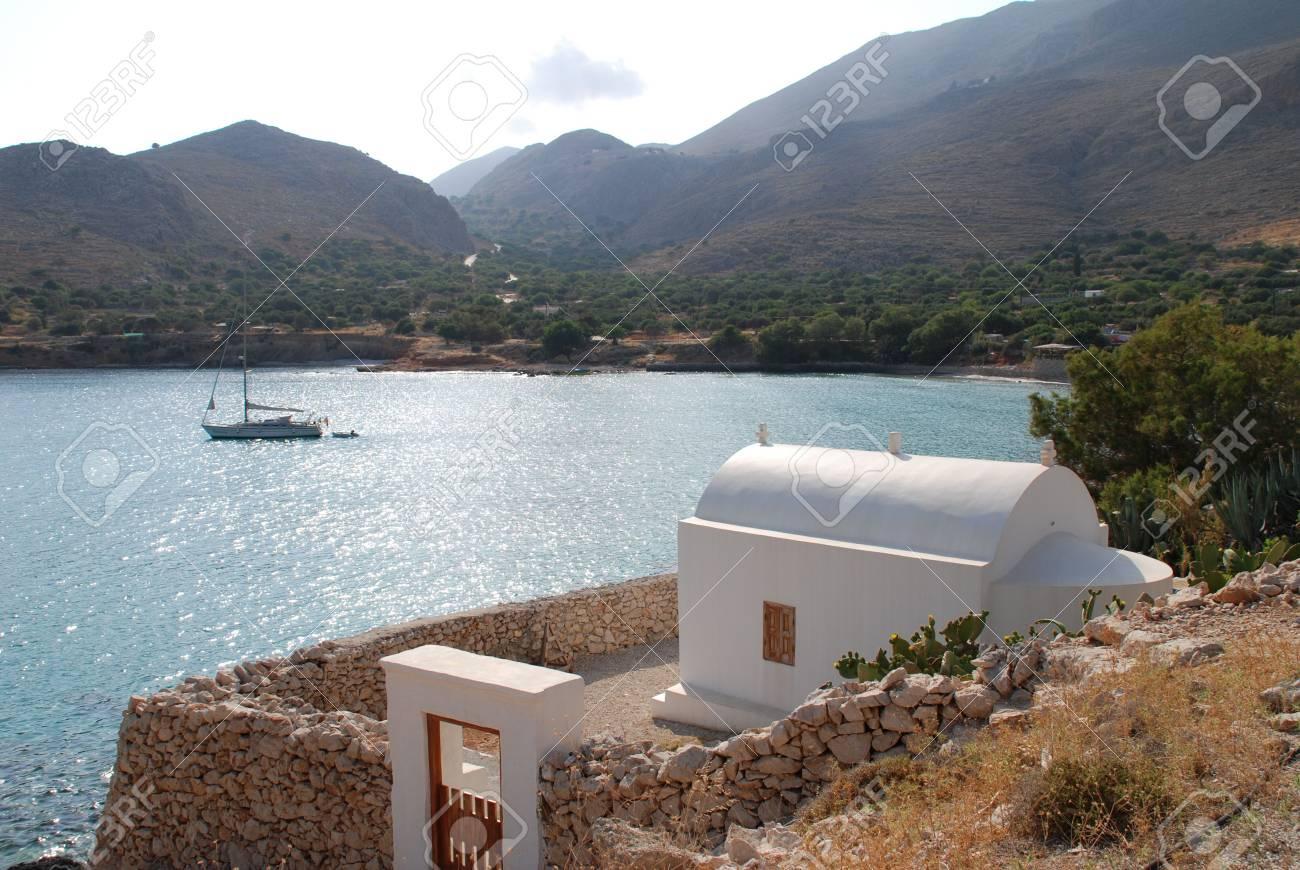 Emborio, Greece - June 4, 2010 - A small chapel above Pondamos beach at Emborio on the Greek island of Halki. Stock Photo - 7996335