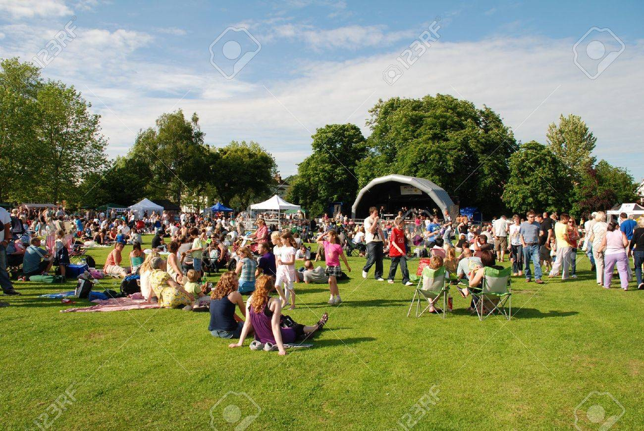 Tenterden, England - June 13, 2009 - Music fans sit on the grass at the Tentertainment local music festival at Tenterden, Kent. Stock Photo - 9309010