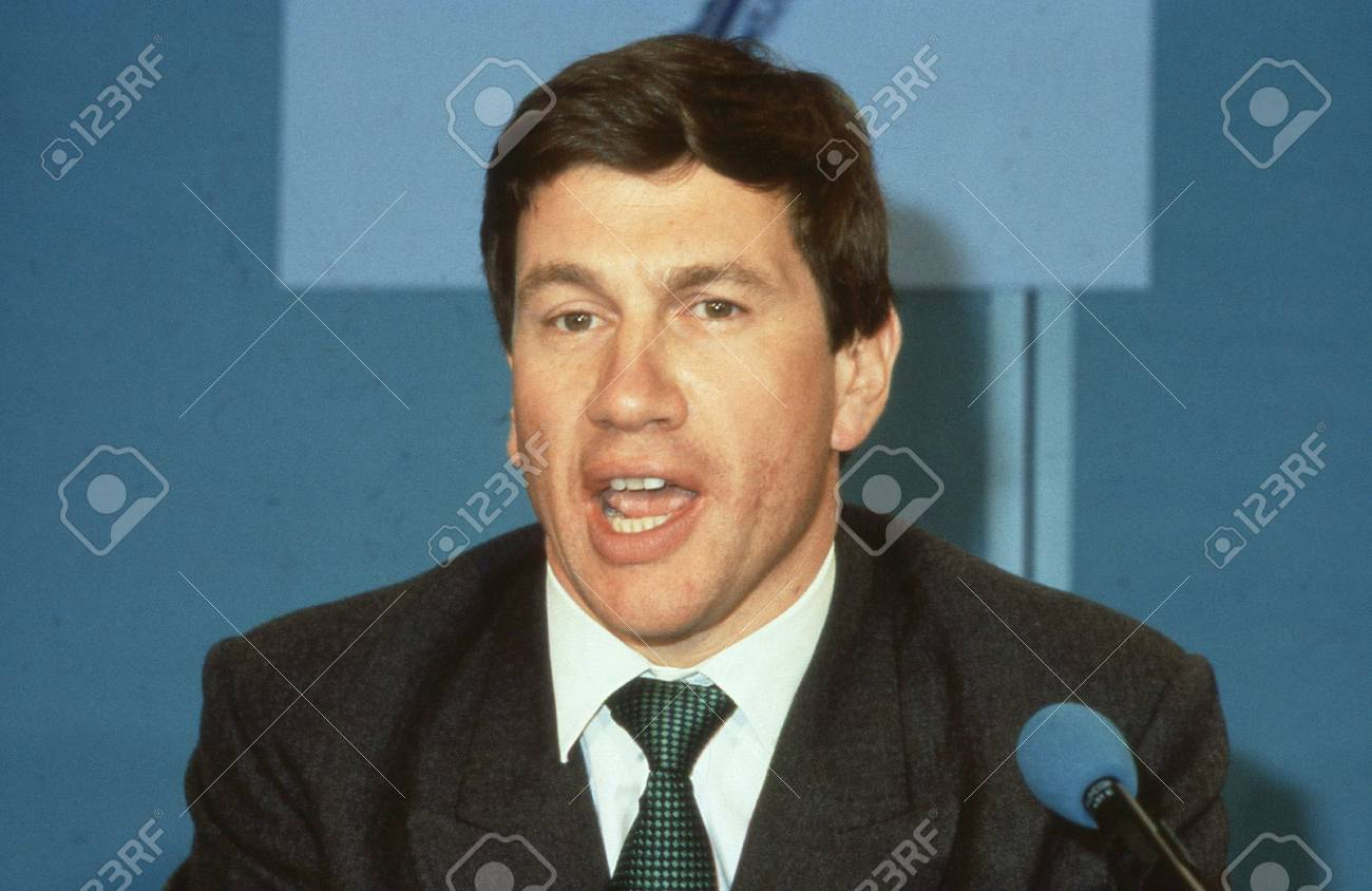 London, England - April 10, 1991 - Michael Portillo, Minister for Local Government and Conservative party Member of Parliament for Enfield, Southgate, speaks at a press conference. He is now a radio and television presenter. Stock Photo - 12779107