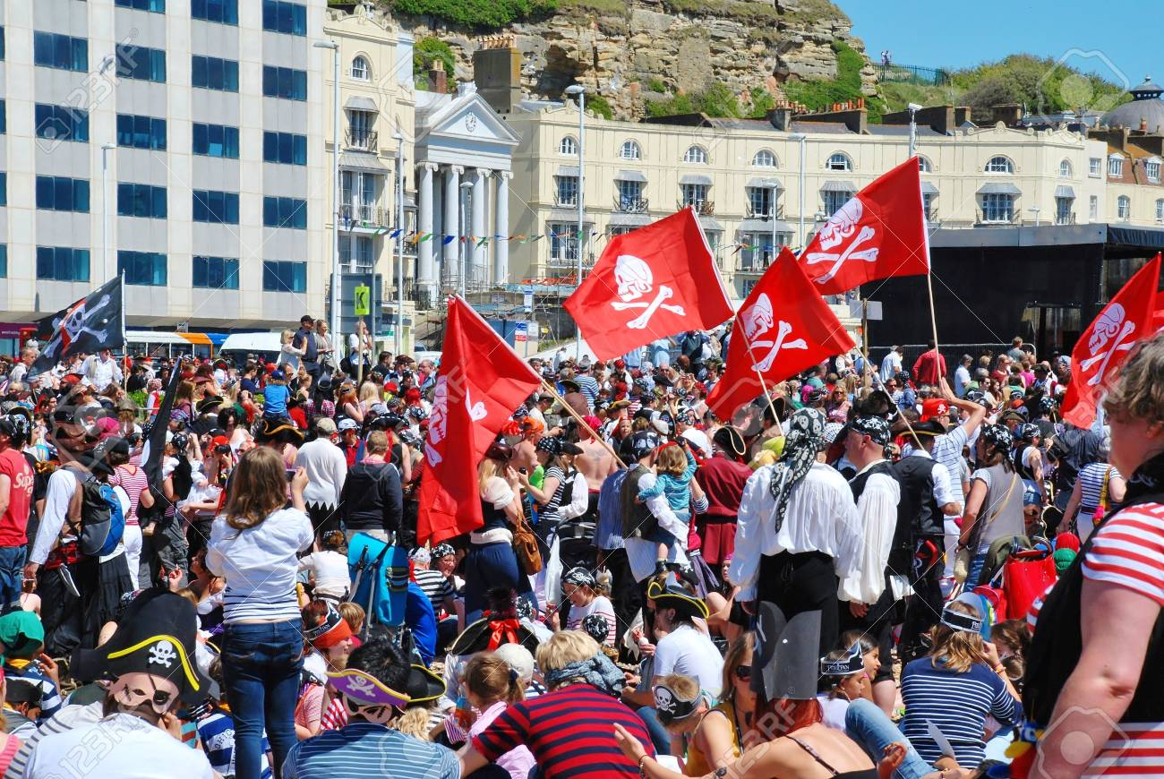 Hastings, England - July 22, 2012 - Pirates assemble on the beach in a  successful attempt to regain the Guinness World Record for the largest gathering of pirates. The annual Pirate Day event was founded in 2009. Stock Photo - 14542018