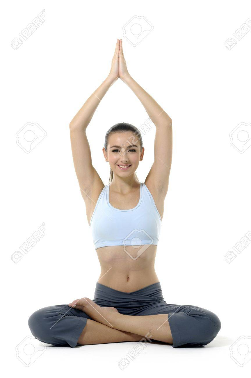 Young woman doing yoga moves or meditating on white Stock Photo - 11221904
