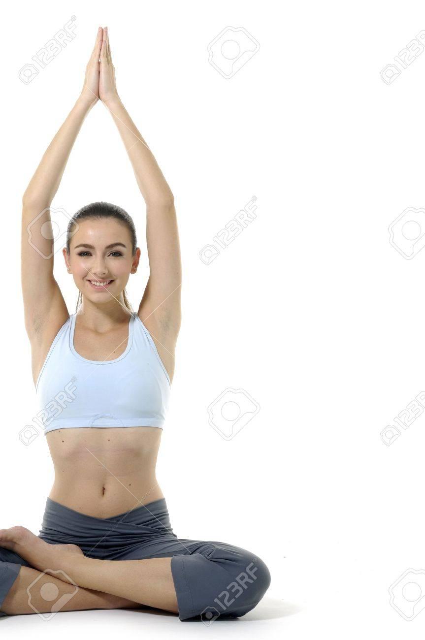 Young woman doing yoga Stock Photo - 12684350