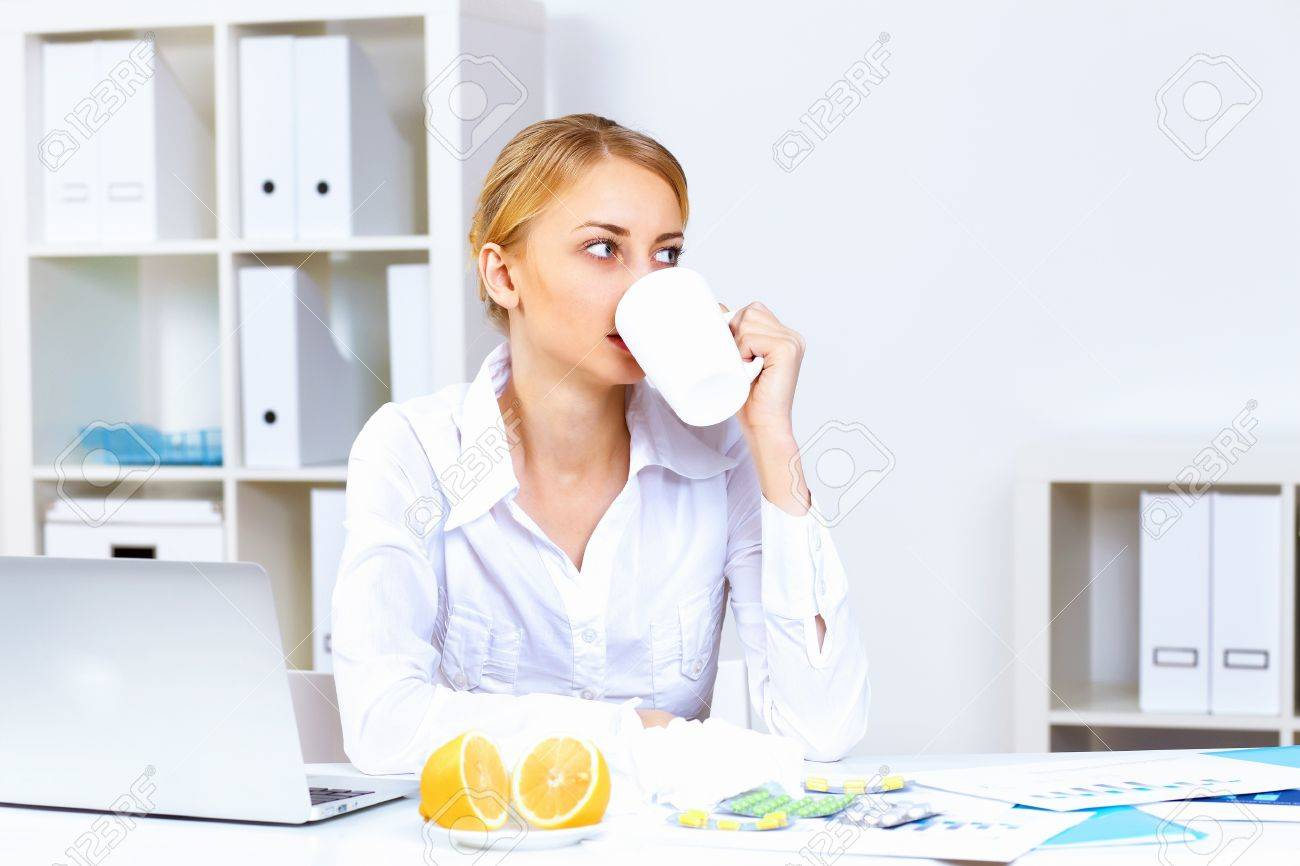 Young woman feeling unwell and sick in office Stock Photo - 11907946