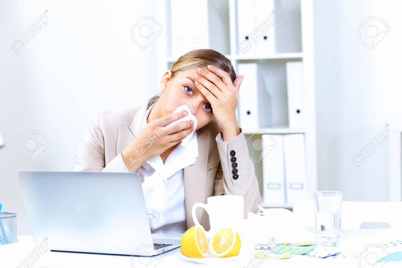 Young woman feeling unwell and sick in office Stock Photo - 11907981