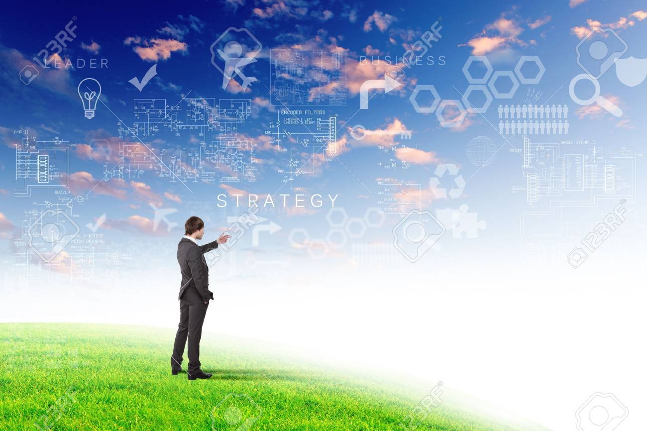 Young businessman outdoor with business symbols on the sky background Stock Photo - 13198132