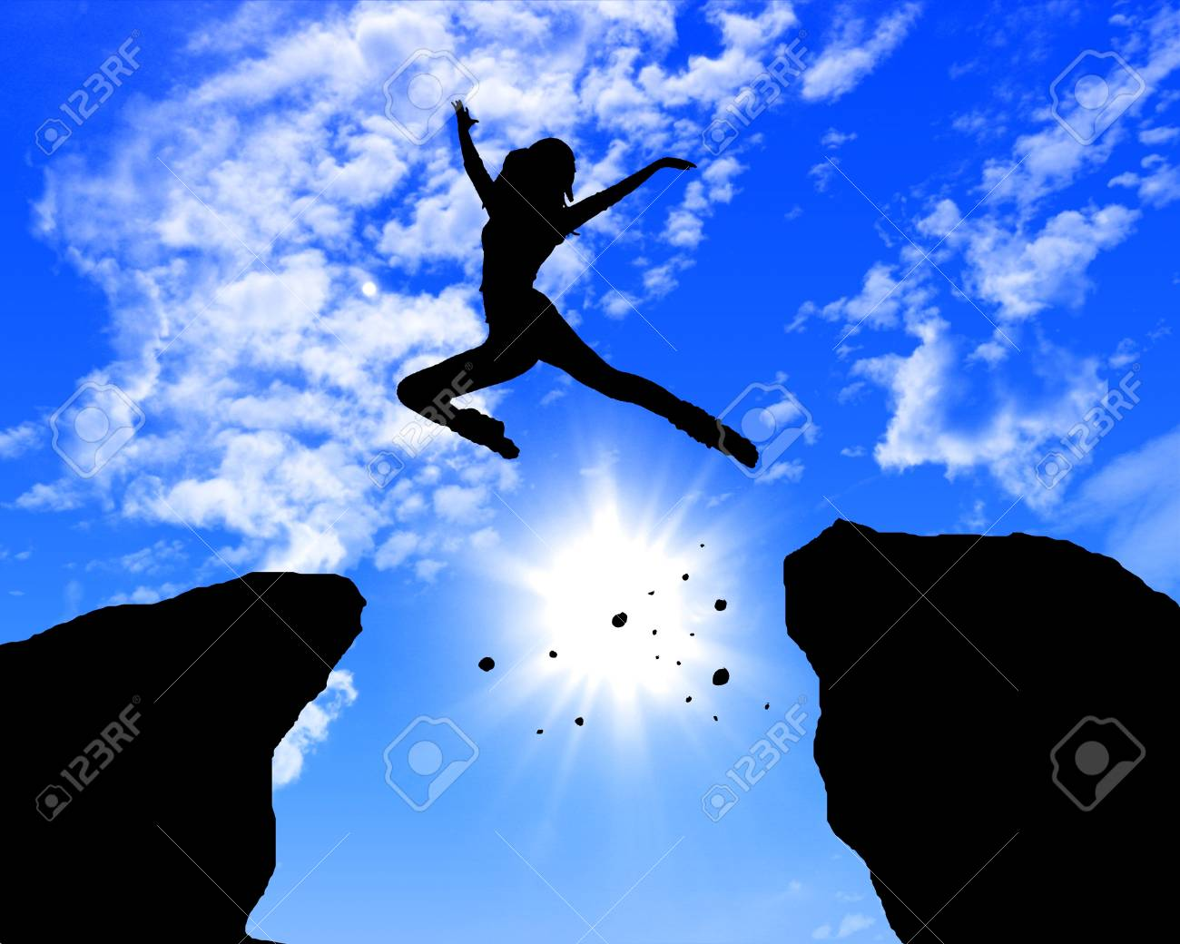 man jumping on the rocks against blue skymountain Stock Photo - 13227553
