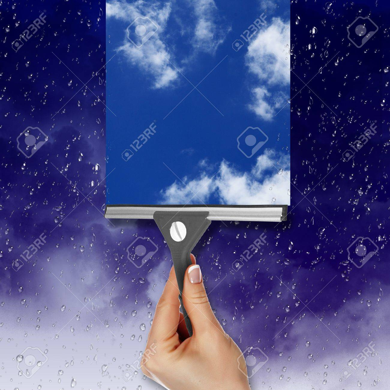 Hand cleaning window with blue sky and white clouds Stock Photo - 13246918