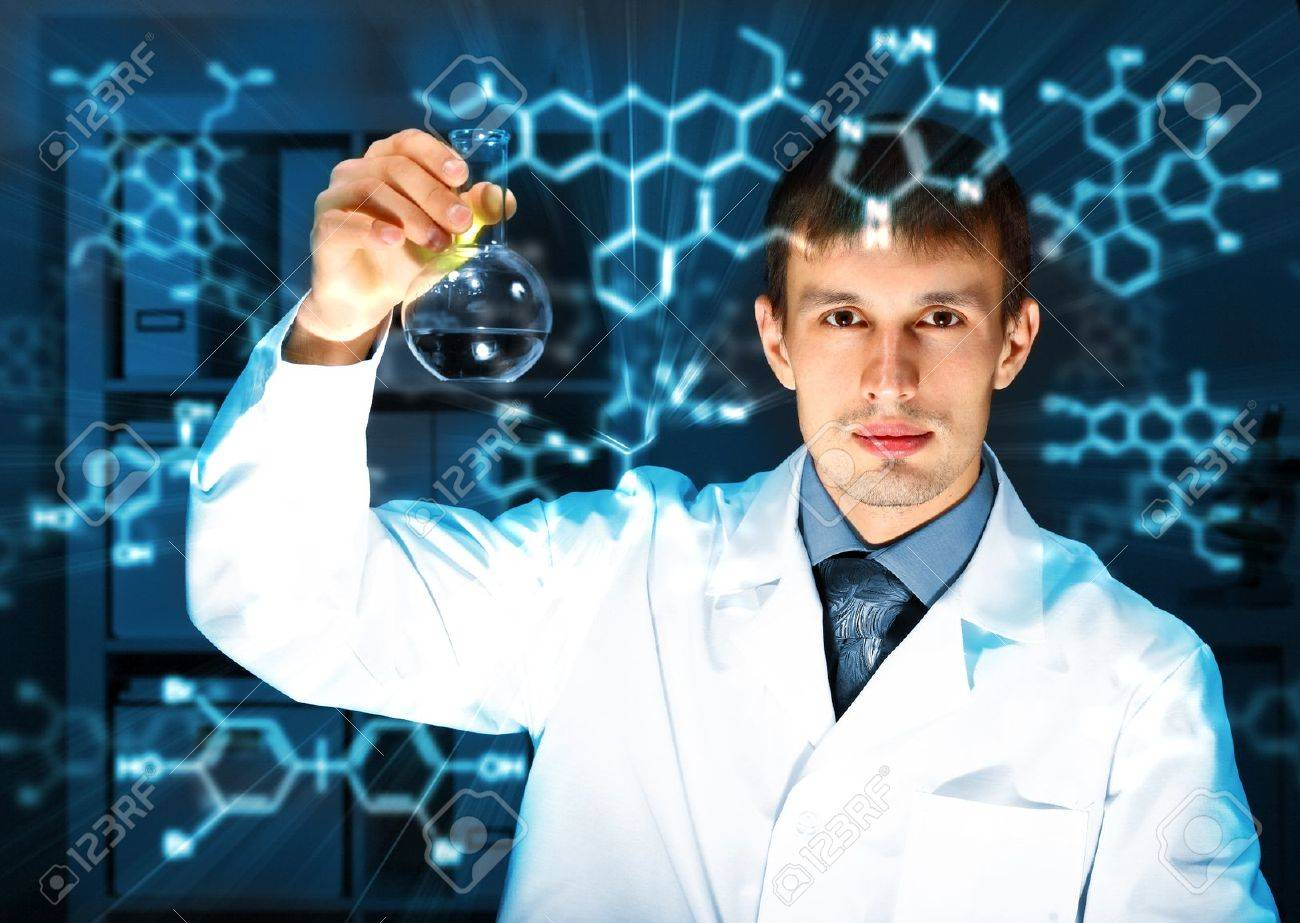 Young chemist in white uniform working in laboratory Stock Photo - 13307133