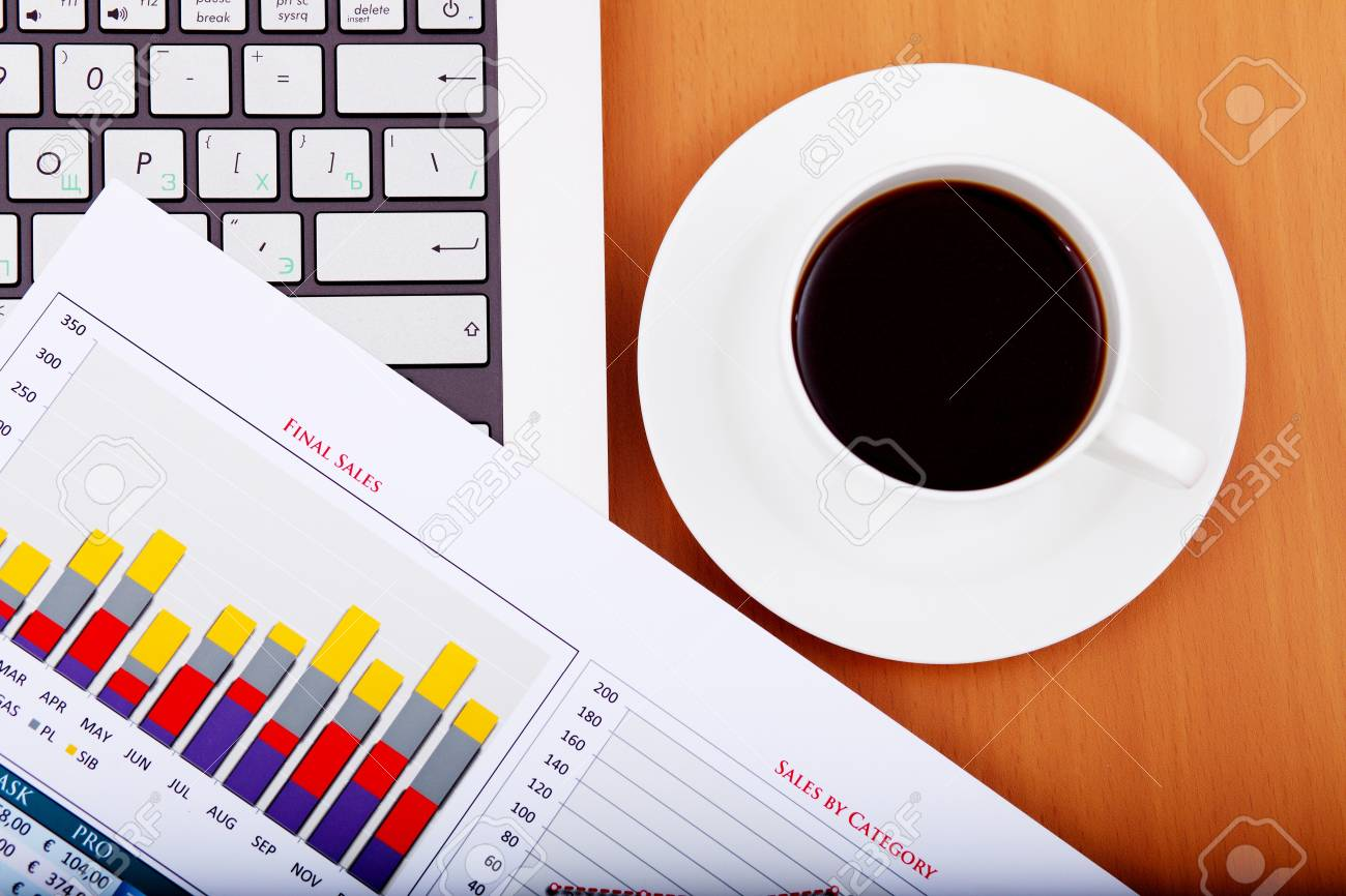 Image of business table with a cup of coffee and norebook Stock Photo - 14068856