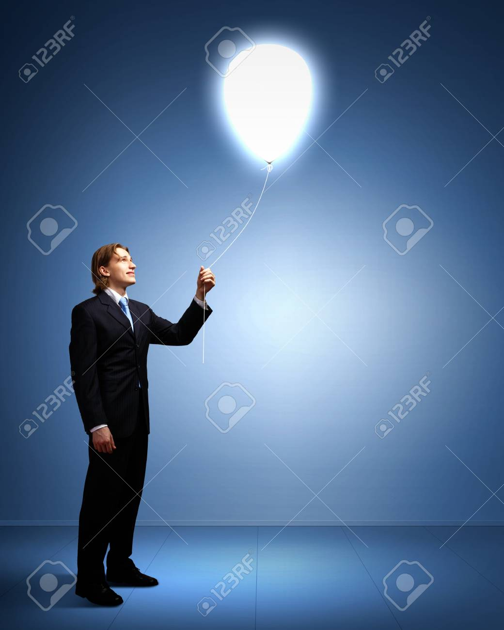 Light bulb and a business person as symbols of creativity in business Stock Photo - 14080545