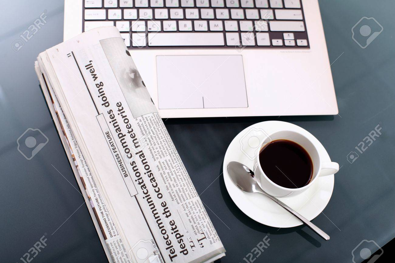 Image of business table with a cup of coffee and norebook Stock Photo - 14522954