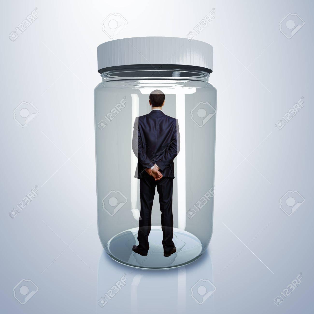 15207512-Businessman-trapped-inside-a-transparent-glass-jar-Stock-Photo.jpg