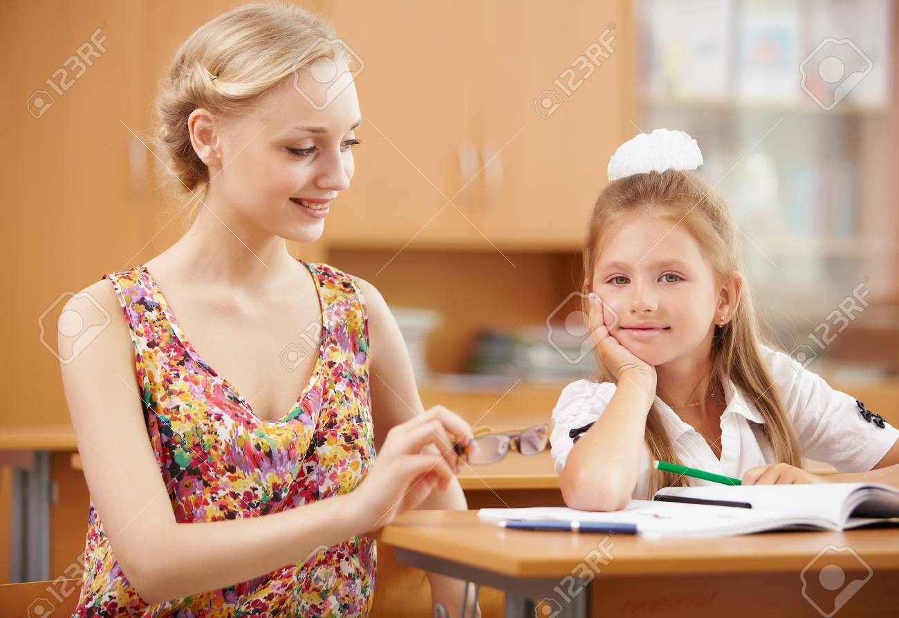 Young female teacher working with children at school Stock Photo - 14955211