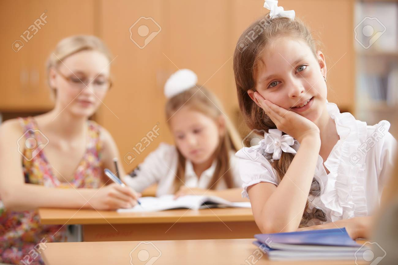 Young female teacher working with children at school Stock Photo - 14955071