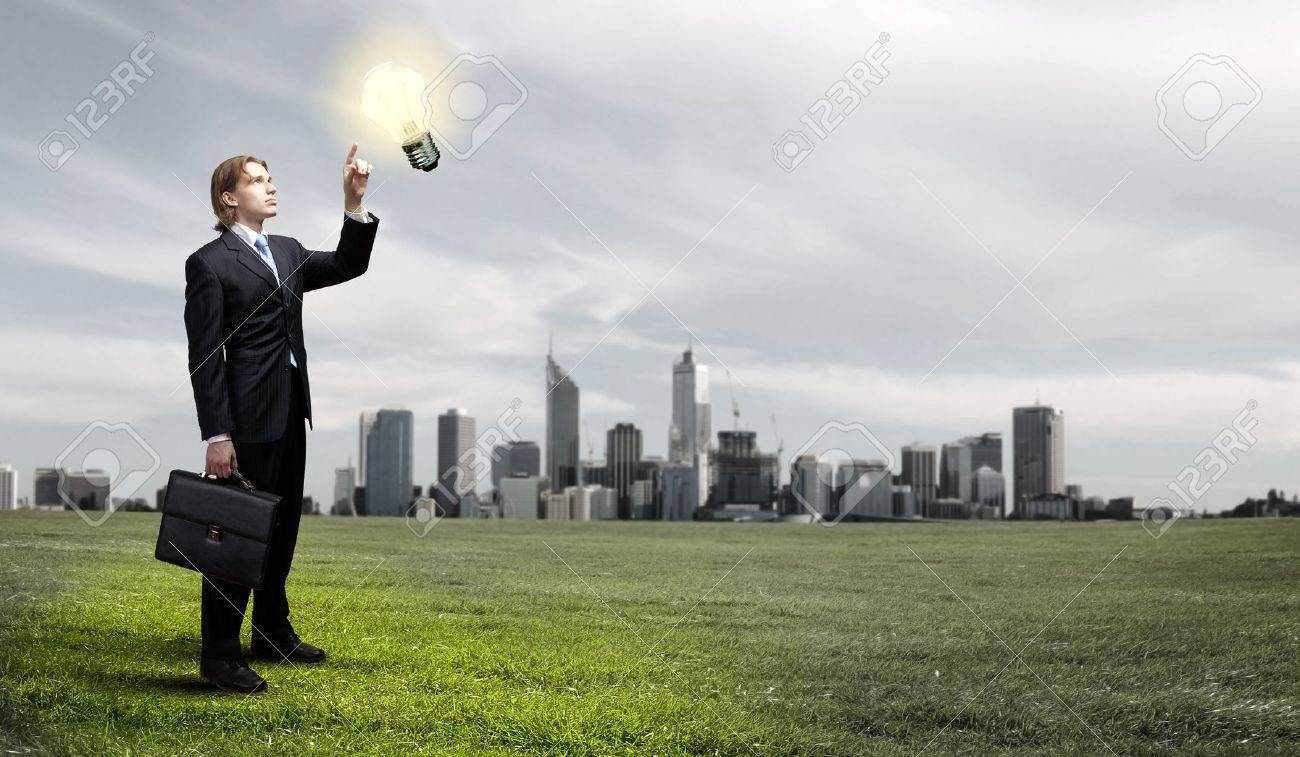 Image of a business man standing against cityscape Stock Photo - 15008830