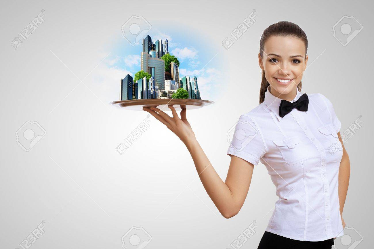 Waitress holding a tray with a symbol of green environment Stock Photo - 15008806