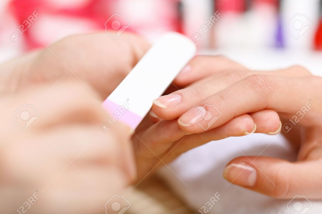 Young woman is getting manicure in a beauty salon Stock Photo - 15493714