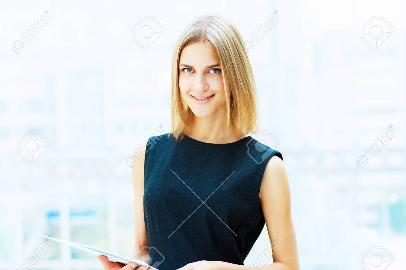 A portrait of a young business woman in an office Stock Photo - 15455780