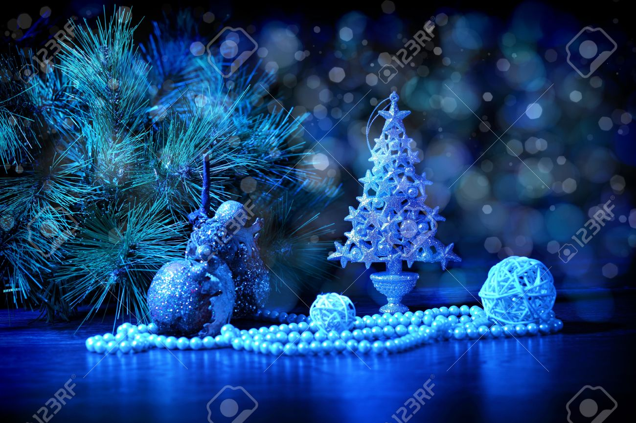 Blue Christmas Collage Decorations And Ribbons On A Blue Background