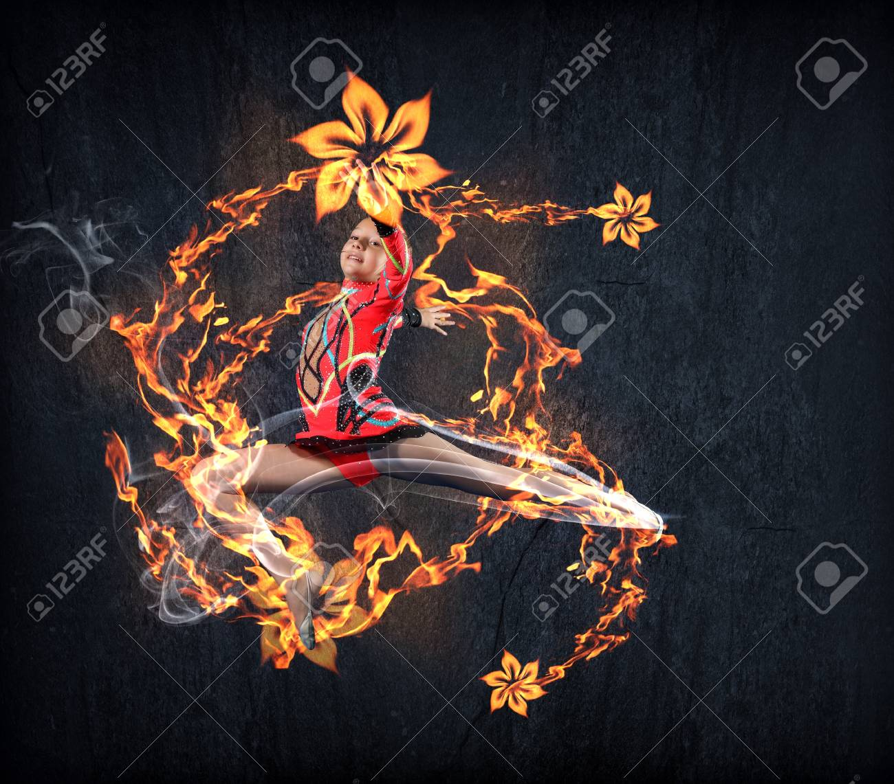 Young cute woman in gymnast suit show athletic skill on black background Stock Photo - 15539541