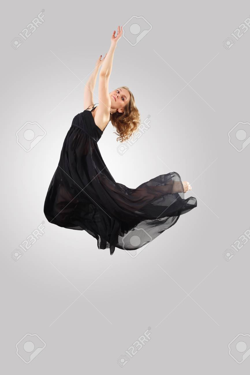 Young female dancer jumping against white background Stock Photo - 15539151