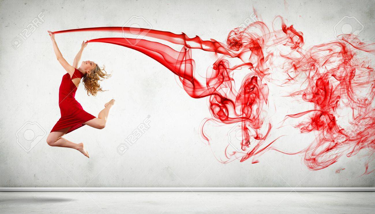 Portrait of a dancing young woman with red smoke curles Stock Photo - 15537197