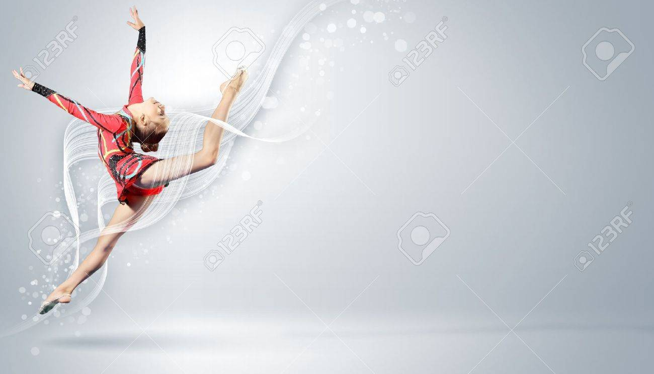 Young cute woman in gymnast suit show athletic skill on white background Stock Photo - 15537260