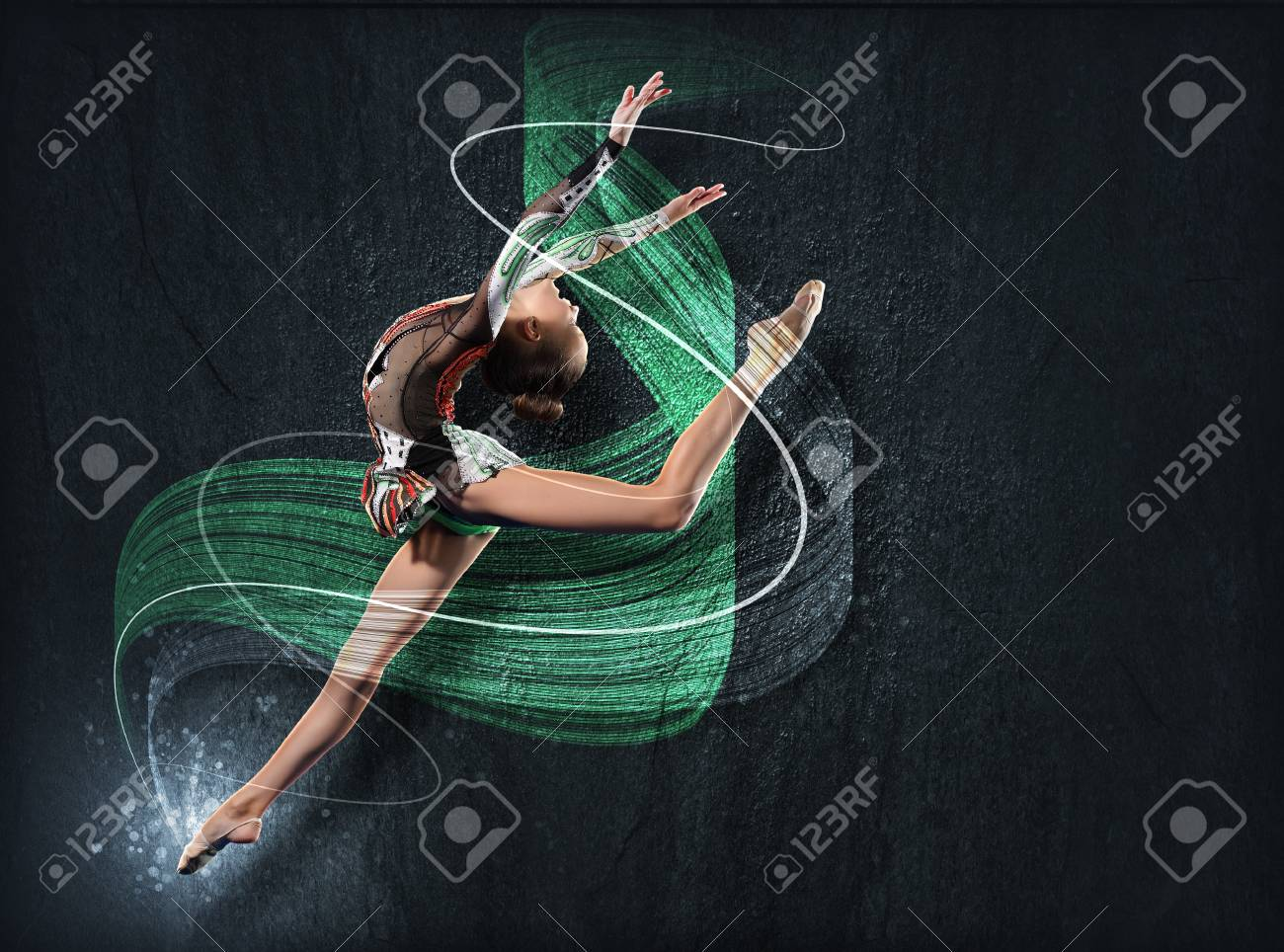 Young cute woman in gymnast suit show athletic skill on black background Stock Photo - 15543437