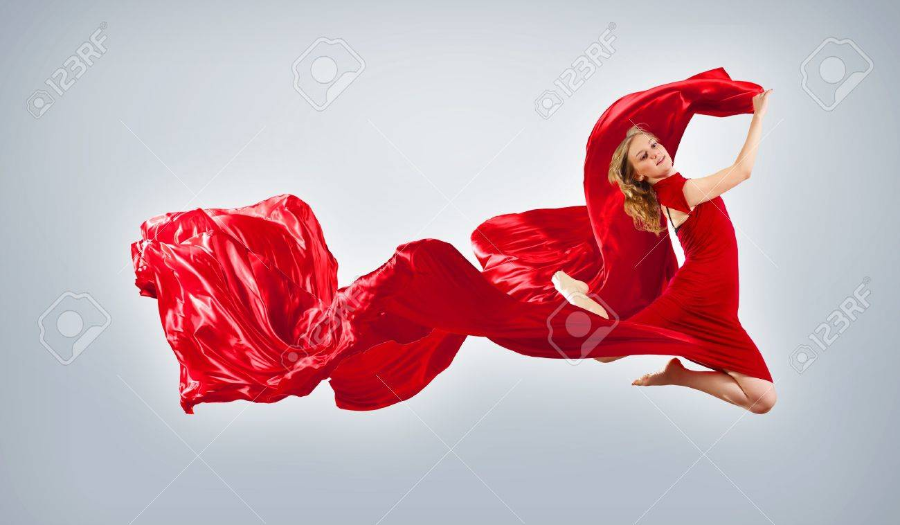 Portrait of a dancing young woman with red fabric Stock Photo - 15685261