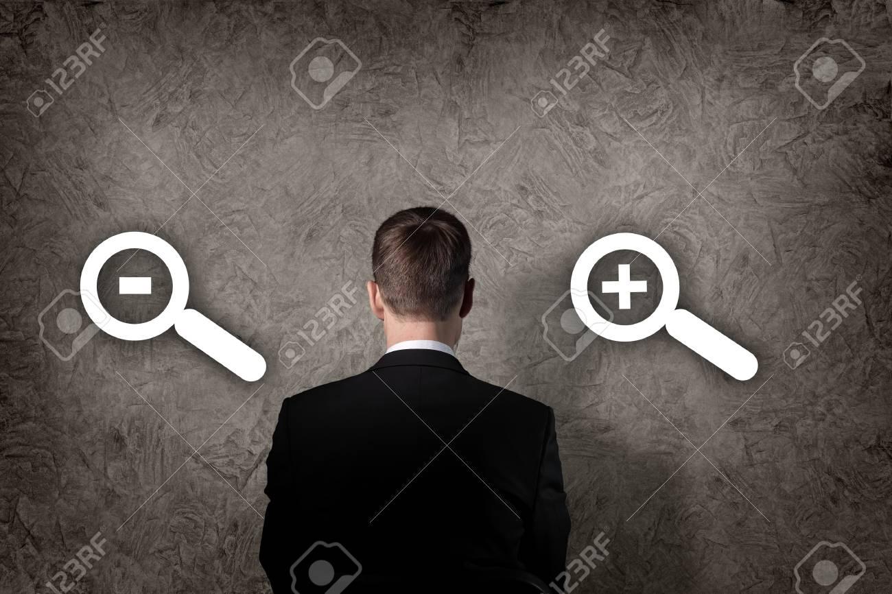Business concept - a businessman choosing decrease or increase Stock Photo - 15862536