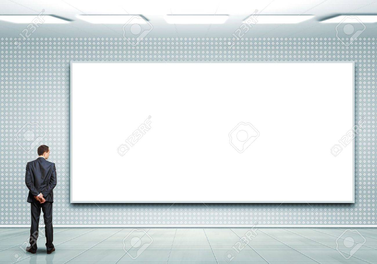 Business person standing near a white blank  billboard Stock Photo - 16117699
