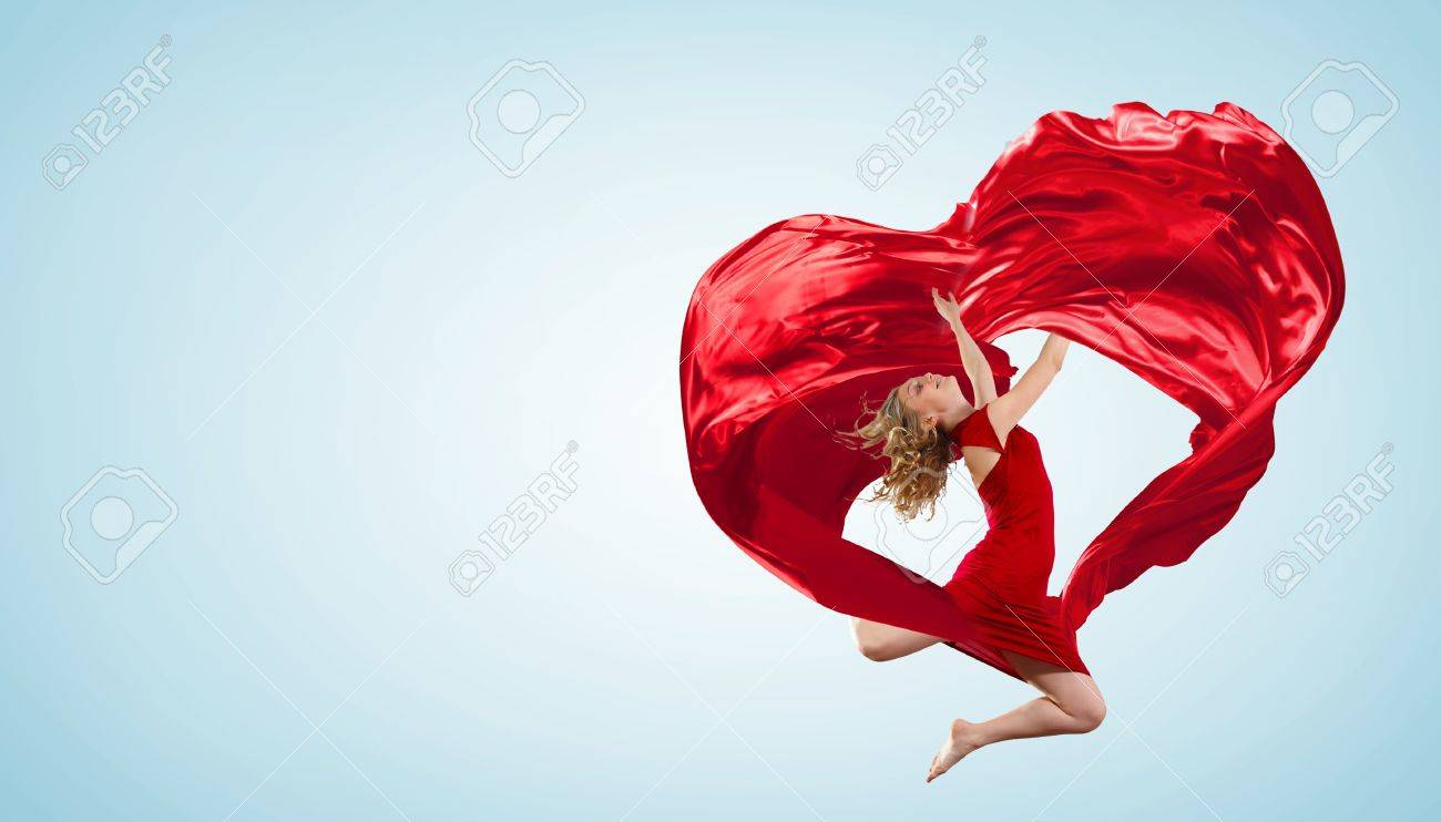 Young woman dancing with red fabric in studio and heart symbol Stock Photo - 16304878