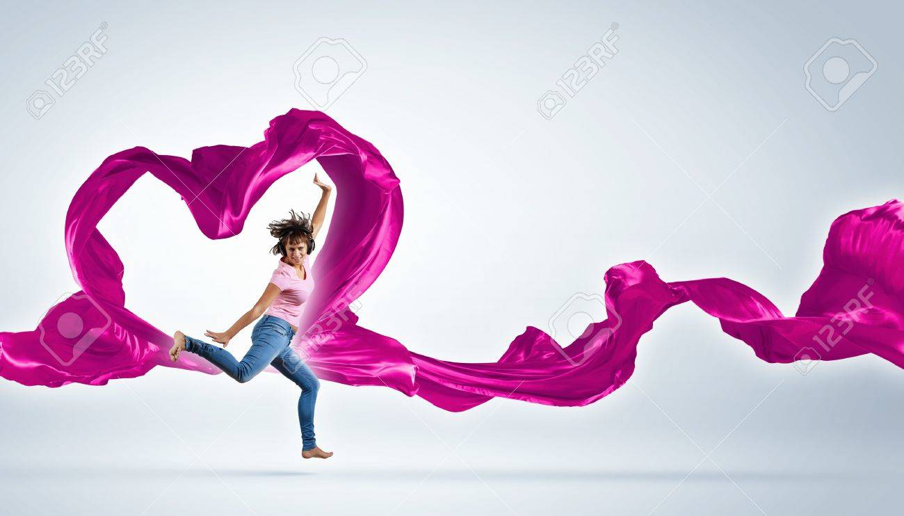Young woman dancing with red fabric in studio and heart symbol Stock Photo - 16226790