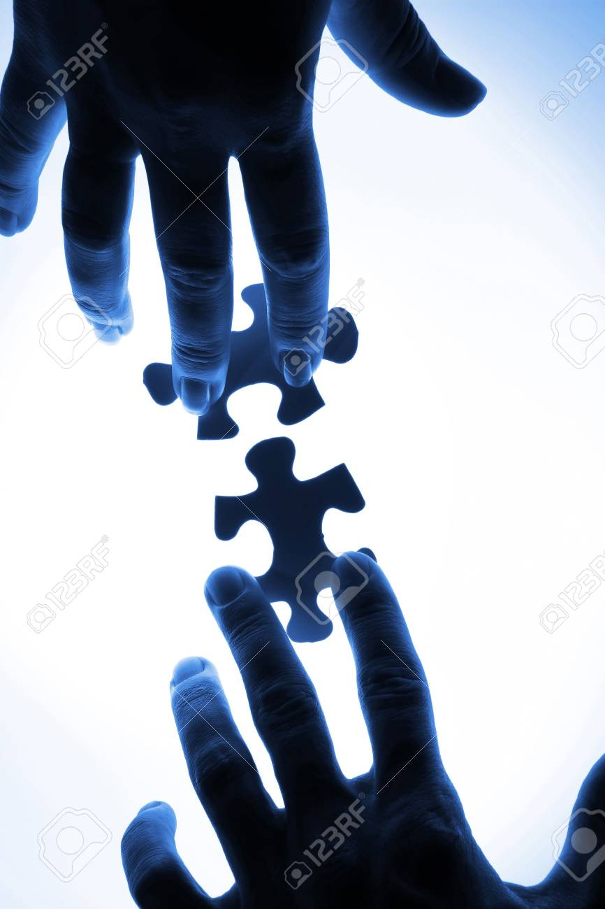 puzzle piece coming down into its place Stock Photo - 16579735