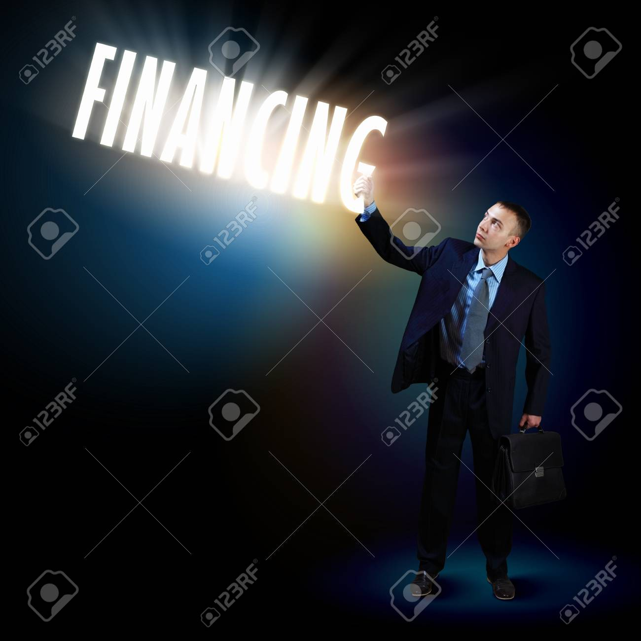 Young successful businessman holding a shining light in his hand as a symbol of success and advancement Stock Photo - 16589710
