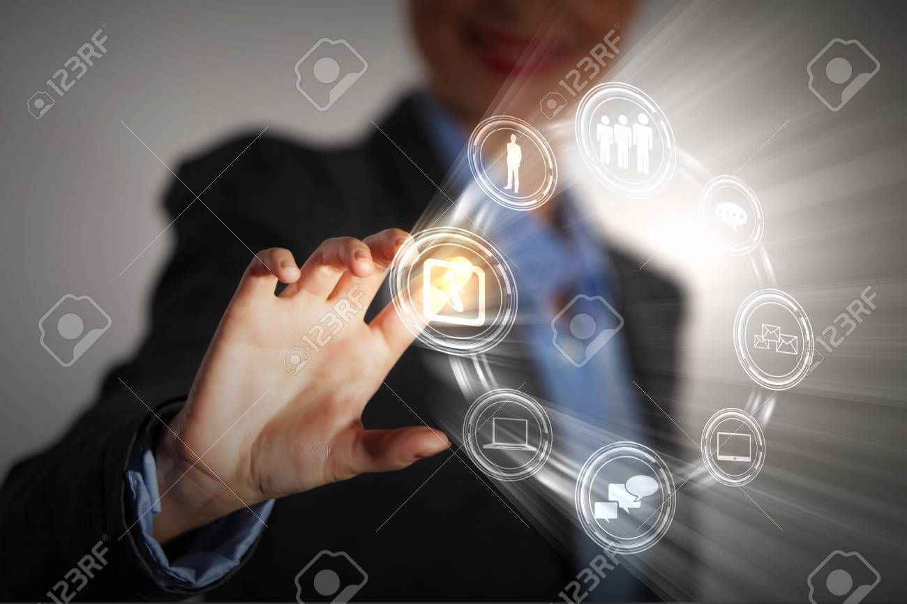 Business person pushing symbols on a touch screen interface Stock Photo - 16589929