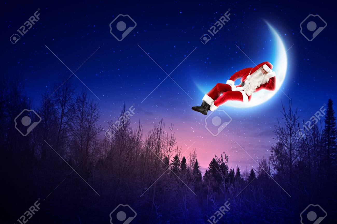 Photo of Santa Claus sitting on shiny moon above winter forest Stock Photo - 16589040