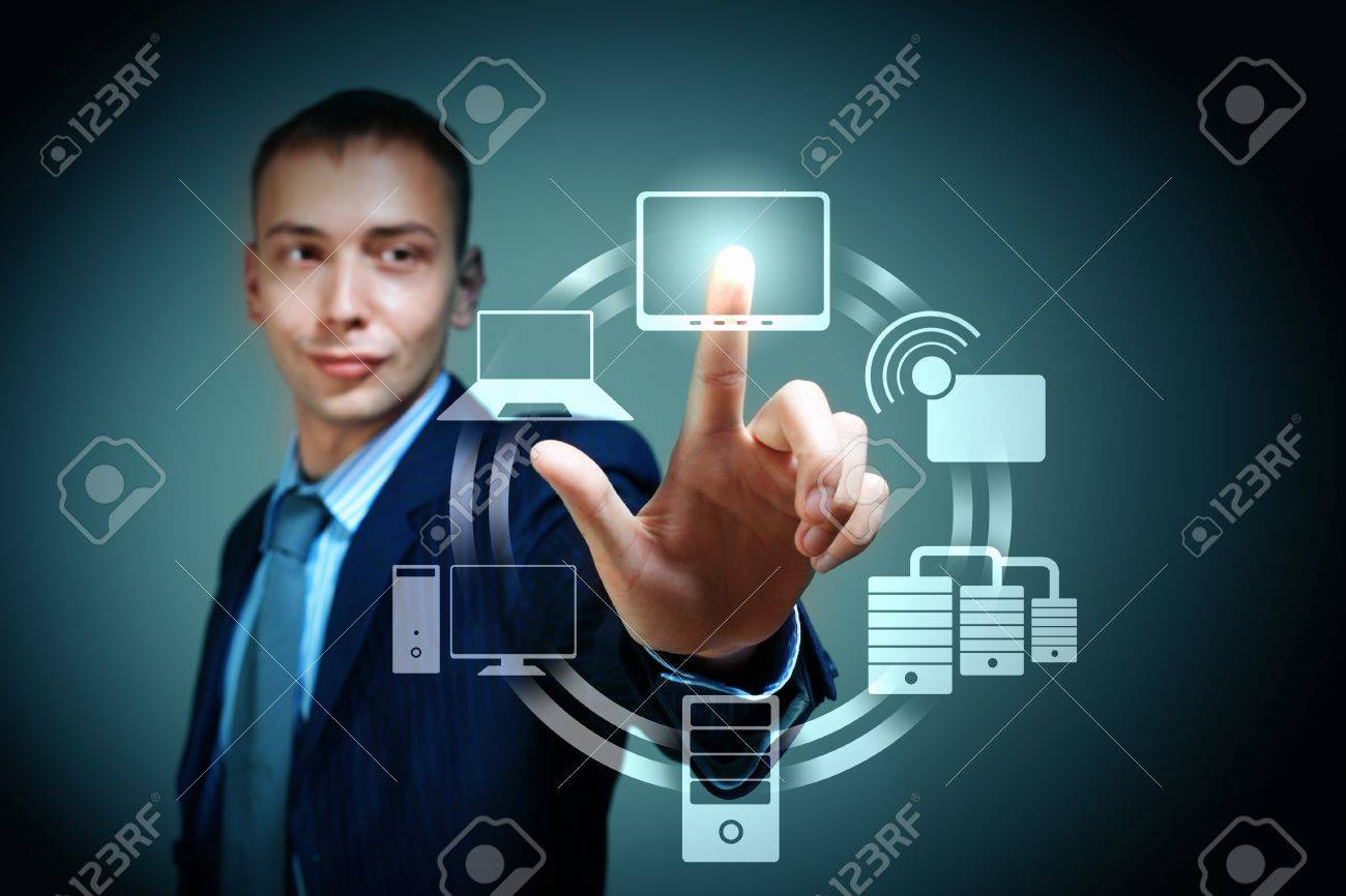 Business person pushing symbols on a touch screen interface Stock Photo - 16616502