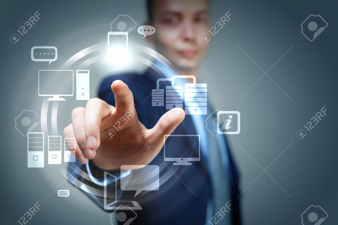 Business person pushing symbols on a touch screen interface Stock Photo - 16616627