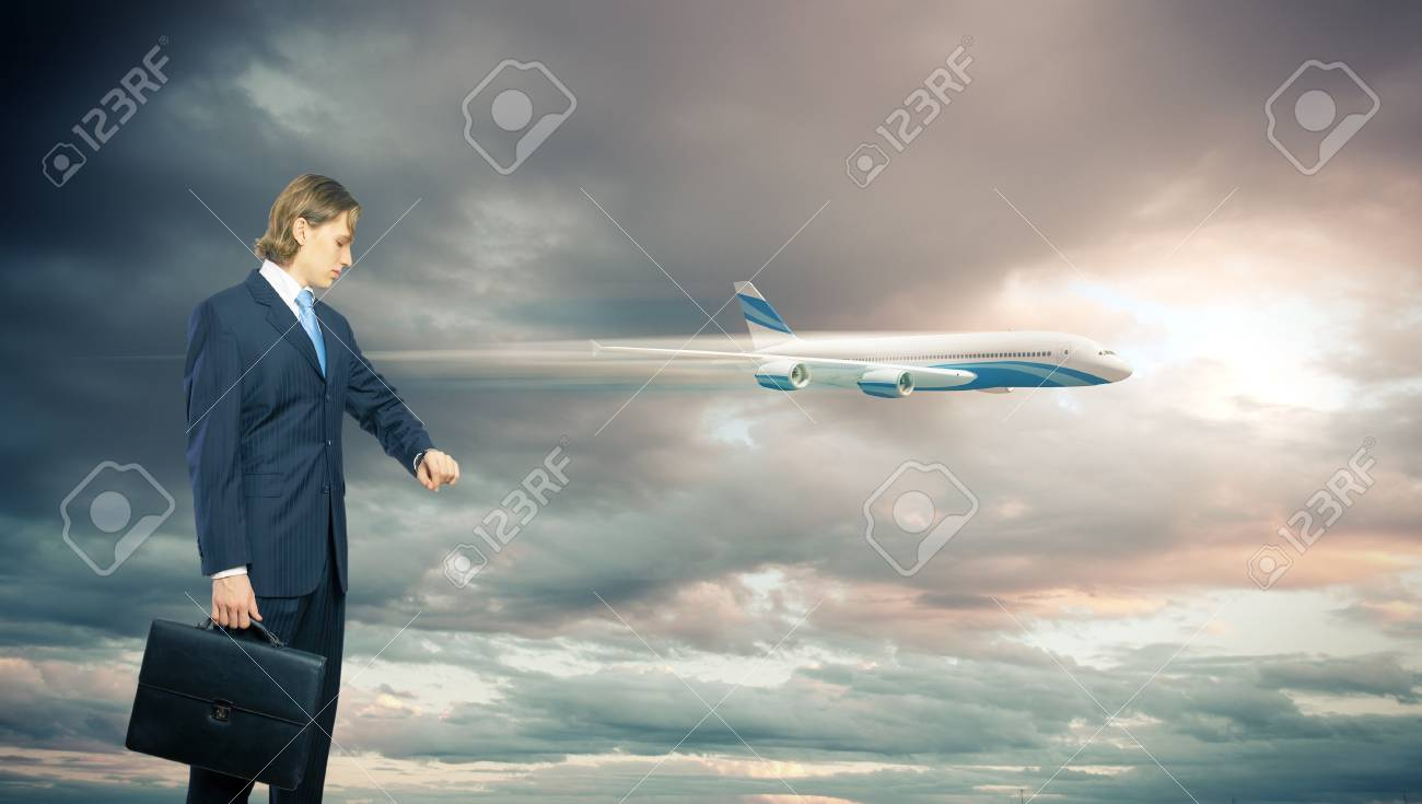 Businesman and plane on the background against cloudy sky Stock Photo - 16671603